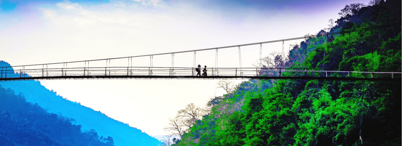 2 people walking on a bridge in Shillong