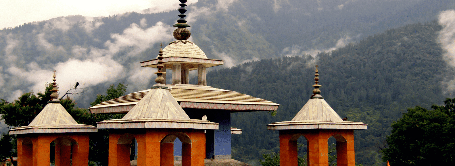Uttarkashi temple image in Ganga valley Uttarakhand with clouds and mountaind behind